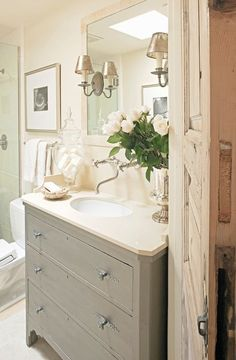small bathroom but luxurious.  Love the cabinet vanity and the light colors.