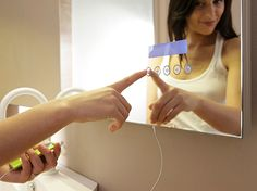 Touch Screen Mirror for playing Ipod. Enjoy Music Lovers!