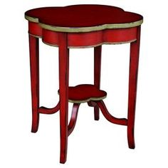 End table with a clover silhouette and antique gold trim.Product:  End table    Construction Material:  Wood  Color: Distressed red    Features: Highlighted with subtle hints of olive   Dimensions: 28 H x 22 W x 22 D   Note: Assembly required