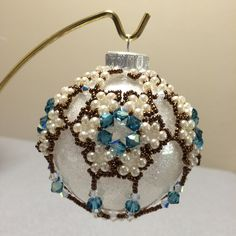 """Beaded Ornament Cover- made Used Cathy Lampole's pattern """"Heirloom Treasures"""". Pretty colorway--I have pattern--PH Beaded Ornament Covers, Beaded Ornaments, Xmas Ornaments, Christmas Bulbs, Beaded Christmas Decorations, Christmas Arts And Crafts, Beaded Jewelry, Beaded Bracelets, Advent"""