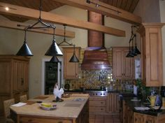 kitchen with copper oven hood | ... of wood? Cabs, table, beams, columns - Kitchens Forum - GardenWeb