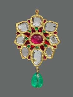 The Imperial crown jewels of Persia Floral Pendant with upswept Petals.Fabricated from gold; worked in kundan technique and set with diamonds, rubies and emeralds; with pendant emerald bead