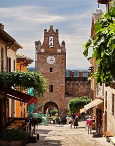 The main street of the medieval walled village of Gradara in Italy | by Anguskirk