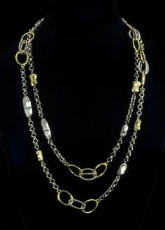 """Rhodium Gold Circle Necklace  Rhodium and 18k gold plated necklace with oval circle design. Necklace length is 47"""""""" with a lobster claw clasp.   http://www.sterlingjewelrystores.com/product647.html"""