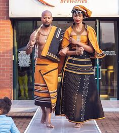 Couple In Beautiful Orange and Black Xhosa Umbhaco Traditional Attire - Clipkulture Couple In Beautiful Orange and Black Xhosa Umbhaco Traditional Attire South African Traditional Dresses, Traditional Outfits, Traditional Weddings, African Wear Dresses, Latest African Fashion Dresses, African Wedding Attire, African Attire, Xhosa Attire, South African Fashion
