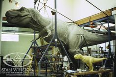 Behind the scenes of JURASSIC PARK. The largest sculpture in the history of Stan Winston Studio stands alongside its 1/5th scale twin.