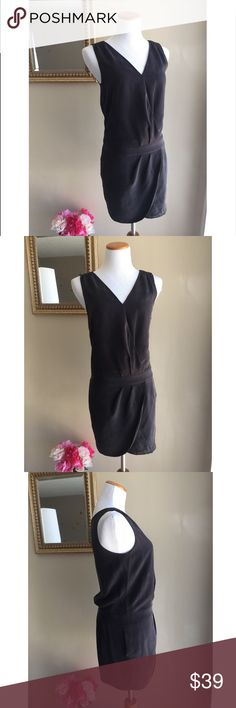 J. Crew Silk Wrap Style Dress This is a beautiful silk wrap style dress in a gorgeous neutral charcoal color. A pocket on each side. Zips up the side. So stunning with a pair of heels! No trades, no PayPal, no holds. J. Crew Dresses