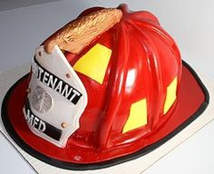 Awesome fire helmet cake.WOWIE thats some excellent fondant work....
