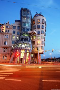 This cool building is located in the Czech Republic, Prague. It is called the Nationale-Nederlanden building.  Locals have nicknamed the building The Dancing House or Fred and Ginger.