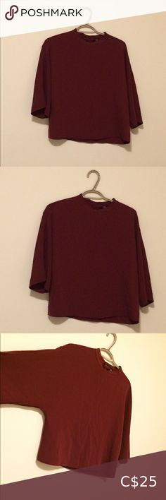 🌻3 for $40 Uniqlo Mock Neck Blouse Fabric is a heavy but silky poly blend. Very substantial and has a great modern shape. One button in the back. In EUC. Colour is more like picture 3 and 4. Such a pretty rusty burgundy colour. Size XS but could fit small too. Uniqlo Tops Blouses Short Sleeve Button Up, Long Sleeve Tops, Burgundy Colour, Oversized Blouse, Yellow Blouse, Black Lace Tops, Knit Skirt