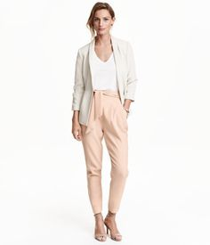 Loose-fit pants in woven fabric with a high, pleat-front waist. Side pockets, welt back pocket, tie belt, and concealed side zip. Tapered legs.