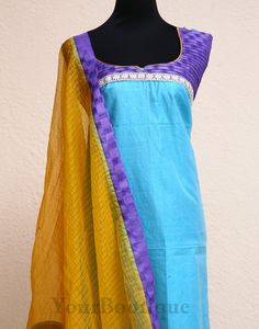 ZL35-5 Sky blue chanderi top with purple self print yoke. Yeloow soft kota dupatta with violet and blue borders.Yellow cotton silk bottom.