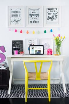 yellow chair. white desk