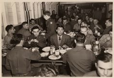 Cary Grant eating with the troops at Camp Crowder.