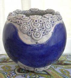 coils on ceramic bowl vase