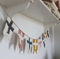 Crocheted bunting with flags.