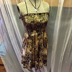 """Leopard Flowy Top Leopard tube top size small in juniors. Flowy and runs longer than a typical top. 26"""" inches long. Worn maybe once. In new condition. Great colors thought and sparkle gold accent! Definite eye catcher ! water water Tops"""
