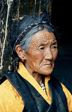 Elder in Tibet... Every line on her face has a story. She has lived a life that is etched on her body. That's Real. That's not like so many who erase the signs of their living from their faces with botox and face lifts.