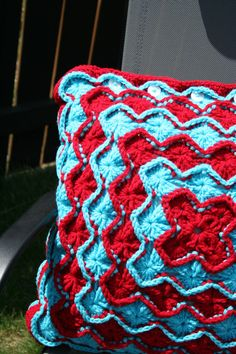Crochet Catherine's Wheel Throw Pillow Cover in Turquoise and Red.