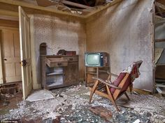 A living room in a cottage on the island of Scalpay - the chair with a favourite blanket t...