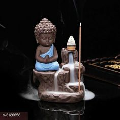 Religious Idols & Paintings Budha Ceramic Smokey Fog Fountain Gift Material: Ceramic Size: L x W - 5 in x 3 in Description: It Has 1 Piece Of Ganesh Statue (5 Cones Free) Country of Origin: India Sizes Available: Free Size   Catalog Rating: ★3.9 (1039)  Catalog Name: Free Gift Elite Budha Ceramic Smokey Fog Fountain Gifts Vol 8 CatalogID_428950 C128-SC1316 Code: 271-3126658-303