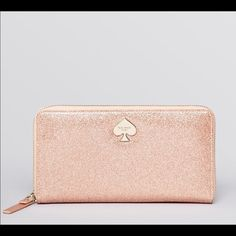 ISO Rose Gold Kate Spade Zip Around Been looking for this wallet! Please help me find it :) kate spade Bags Wallets
