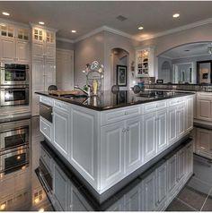 Black granite tile w/ black granite countertops and white cabinets.