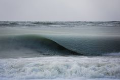 """Photos: Cold Temps Create Slurpee Waves - In New England, it's gotten so cold that even waves are starting to freeze. Surfer Jonathan Nimerfroth took Incredible photos of so-called """"slurpee waves"""" in Massachusetts."""