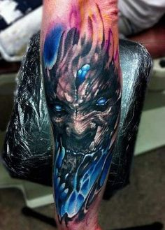 Black blue demon tattoo on forearm