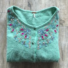 FREE PEOPLE Bejeweled Cardigan Ask all your questions before purchasing. Teal with jewels sewed onto back and collar! 49% Wool, 20% Angora, 31% Nylon Free People Jackets & Coats