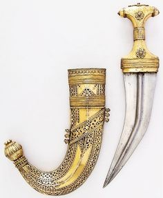 Arabian jambiya, 19th century, steel, wood, brass, silver, gold, copper, brass wire, H. with sheath 13 1/4 in. (33.7 cm); H. without sheath 12 7/8 in. (32.7 cm); W. 2 7/8 in. (7.3 cm); Wt. 13.4 oz. (37.9 g); Wt. of sheath 18.6 oz. (527.3 g), Met Museum, Bequest of George C. Stone, 1935. Swords And Daggers, Knives And Swords, Damascus Sword, Muslim Culture, Dagger Knife, Arm Armor, Knife Sets, Museum Collection, Almost Always