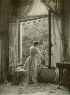 1910... what a gorgeous photo of woman  grand window with lace curtains!  Too pretty not to post.