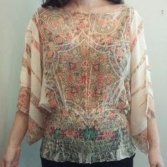 """Boho printed blouse Drapey and feminine top with pretty floral design and wide sleeves. Elastic at the waistline hugs the hips or waist. Design Works brand. Model is 5'5"""", 140 lbs. Polyester. Made in USA. Design Works Tops Blouses"""