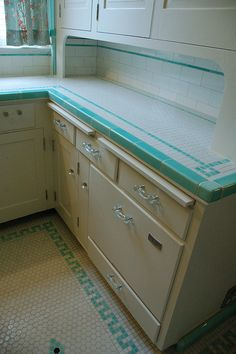 GORGEOUS Depression Era Kitchen- I would flip out if I found a house with a kitchen like this. Sad thing is so many people would rip this out and put in something so...big box...