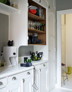 I love the gray walls for a kitchen. Gray and yellow?
