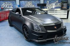 The Good: Matte Black CTS V Coupe, sleek, mean, gorgeous.  The Bad: Justin Bieber owns it.