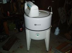 i loved watching my gran do the laundry on the back porch in the summer.... wringer washer fascinated me!
