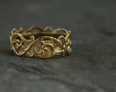 Check out this item in my Etsy shop https://www.etsy.com/listing/177897655/gold-wedding-band-filigree-lace-gold