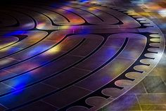 Portion of #labyrinth at Grace Cathedral with stained glass reflection.