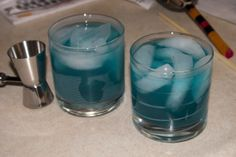 Grand Blue Drink Recipe  1 1/2 cl. Blue Curacao  1 1/2 cl. Peach Schnapps  1 1/2 cl. Malibu Coconut Rum  3 cl. Sweet & Sour mix  Serve in an old fashioned glass.  This was really delicious.