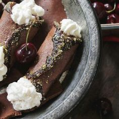 Black Forest Cannoli:: Chocolate cannoli stuffed with roasted cherries and Kirsch whipped cream.