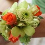Mix Flower Wrist #Corsage Price:  $22.98 Spray Roses, dendrobium orchids, and poms with a green ribbon