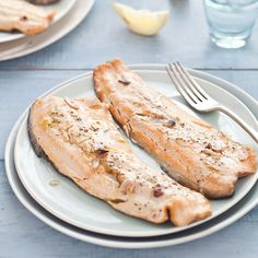 Tuscan Grilled Trout: A simple Garlic and Herb infused Oil combined with Wine Vinegar acts as both a Basting Liquid and a Sauce for the Fish. The trout skin protects the fl. Grilled Halibut, Grilled Fish, Grilled Seafood, Baked Fish, Tilapia Recipes, Seafood Recipes, Grilled Trout Recipes, Garlic Recipes, Savoury Recipes