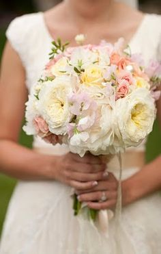 Beautiful white pale pink and pale yellow bridal bouquet for wedding flowers