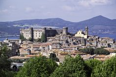 Located just an hour from Rome by train, the town and lake of Bracciano make the perfect escape. The medieval town is quaint and lovely; the Odescalchi castle has been the residence of two different papal families (the Borgias and Orsini) Places In Italy, Places To See, Beautiful Castles, Beautiful Places, Day Trips From Rome, Castle Pictures, Haunting Photos, Medieval Town, By Train