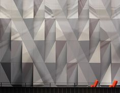 Kilden Performing Arts Center by ALA Architects.  Theater wall detail composed of folded metal panels.  Photo: courtesy of architects/Dezeen.