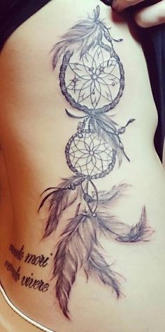 One double dreamcatcher. Would look sweet on the outside of my right calf. But I would add some color to it like turquoise and reds