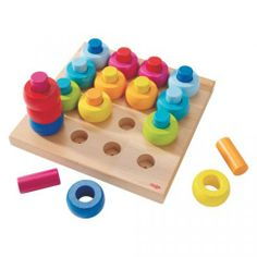 Rainbow Whirls Pegging Game #oompatoys #habausa    This looks like a great game for young ones just mastering hand-eye coordination. It looks beautiful, too.
