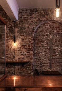 Industrial look- brick, copper, simple lighting