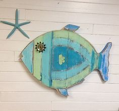 Fish Wall Art Sign Beach House Sea Glass Colours Decor by CastawaysHall  This round weathered wood fish is so cool in all the lighter colours of sea glass. Colour upon colour layered on each other and highly distressed. It even has a vintage round glass piece with lovely metal eyelashes for an eye. This one of a kind fish would look fantastic on a mantle at the beach house, in a bathroom, on a feature wall or even over a bed. Comes ready to hang as shown.  Made to Order. Please allow 10…